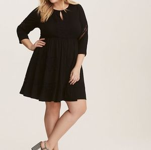TORRID | Black dress with lace detailing.